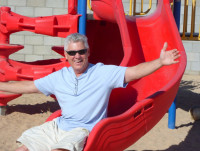 Robert Lewis playing on the slide