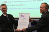 Handing over an ESD Certificate to the dean of a university department