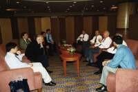 Hongyi Lai in a meeting with Lee Kuan Yew