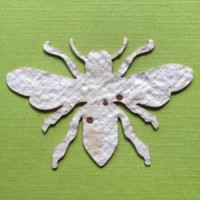 One of 10,000 handmade paper bees