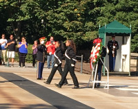Presenting flowers to honor the fallen heroes in Arlington National Cemetery