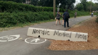 Why do bike riders want a Nordic Model Now! on a bike route in Vancouver?