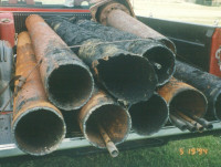 biofouled and corroded pump column pipe