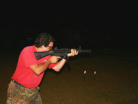 The author demonstrates the H&K MP-5SD