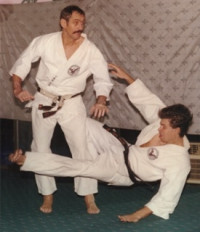 Dr. Arus demonstrates a karate leg sweeping technique